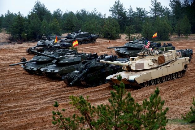 FILE PHOTO: U.S., German, Spanish and Polish troops of the NATO enhanced Forward Presence battle goups with their tanks get ready for the Iron Tomahawk exercise in Adazi, Latvia October 23, 2018. REUTERS/Ints Kalnins