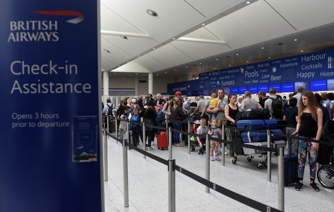 FILE PHOTO - People queue with their luggage for the British Airways check-in desk at Gatwick Airport in southern England, Britain, May 28, 2017. REUTERS/Hannah McKay