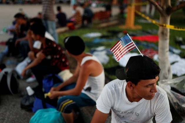 Jose Garcia, a migrant from Honduras en route to the United States, rests in a public square as he waits to regroup with more migrants, in Tecun Uman, Guatemala October 25, 2018. REUTERS/Carlos Garcia Rawlins