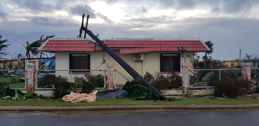 A downed power line sits on a damaged building after Super Typhoon Yutu hit Saipan, Northern Mariana Islands, U.S., October 25, 2018 in this image taken from social media. Brad Ruszala via REUTE