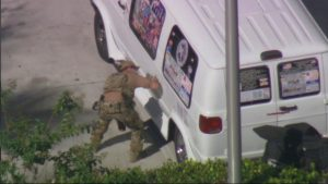 A law enforcement officer checks a van which was seized during an investigation into a series of parcel bombs, in Plantation, Florida October 26, 2018 in a still image fro video. WPLG/Handout via REUTERS