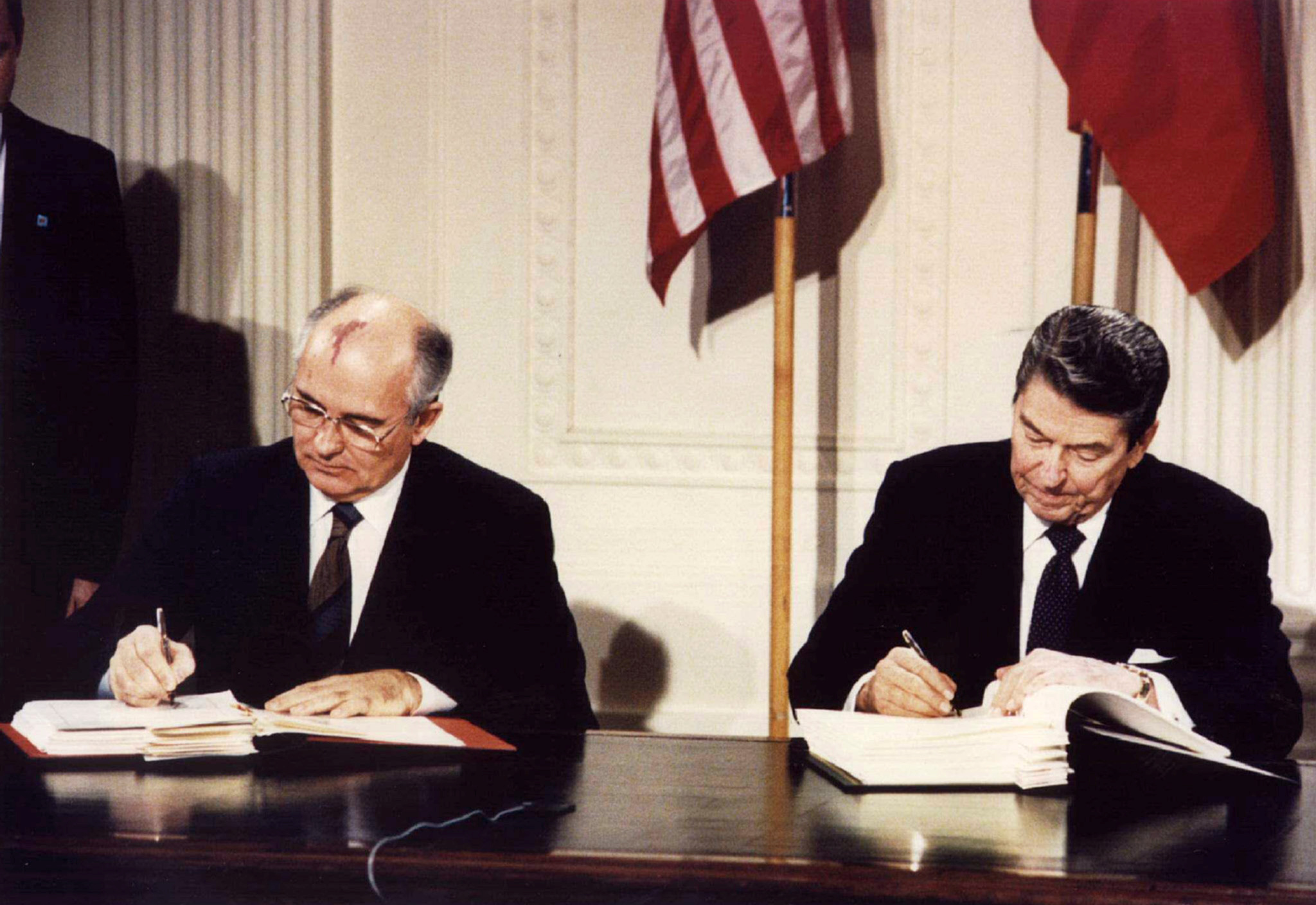FILE PHOTO: U.S. President Ronald Reagan (R) and Soviet President Mikhail Gorbachev sign the Intermediate-Range Nuclear Forces (INF) treaty at the White House, Washington, on December 8 1987. REUTERS/Stringer
