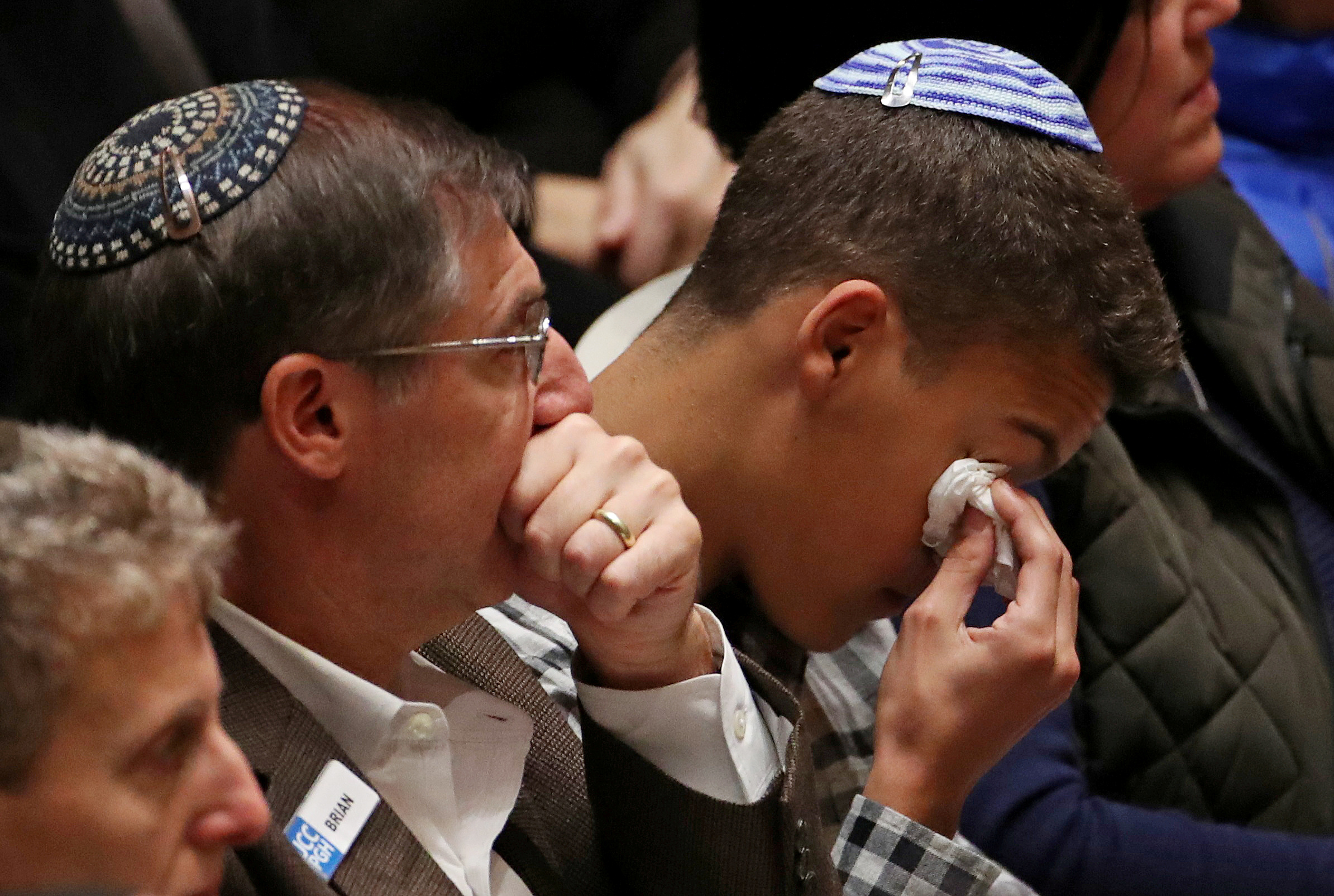 FILE PHOTO: Mourners react during a memorial service at the Sailors and Soldiers Memorial Hall of the University of Pittsburgh, a day after 11 worshippers were shot dead at a Jewish synagogue in Pittsburgh, Pennsylvania, U.S., October 28, 2018. REUTERS/Cathal McNaughton