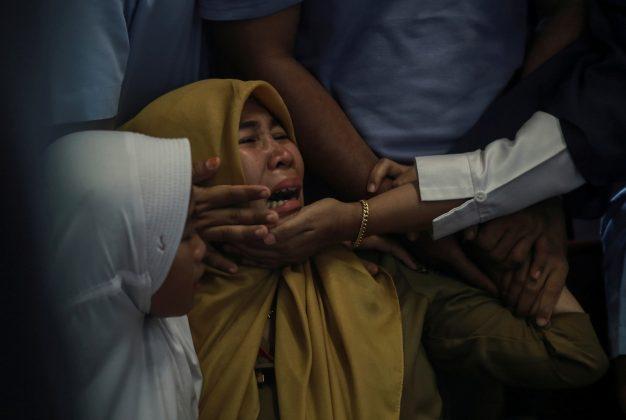 Relatives of passengers of Lion Air, flight JT610, that crashed into the sea cry at Depati Amir Airport in Pangkal Pinang, Belitung island, Indonesia, October 29, 2018. Antara Foto/Hadi Sutrisno via REUTERS