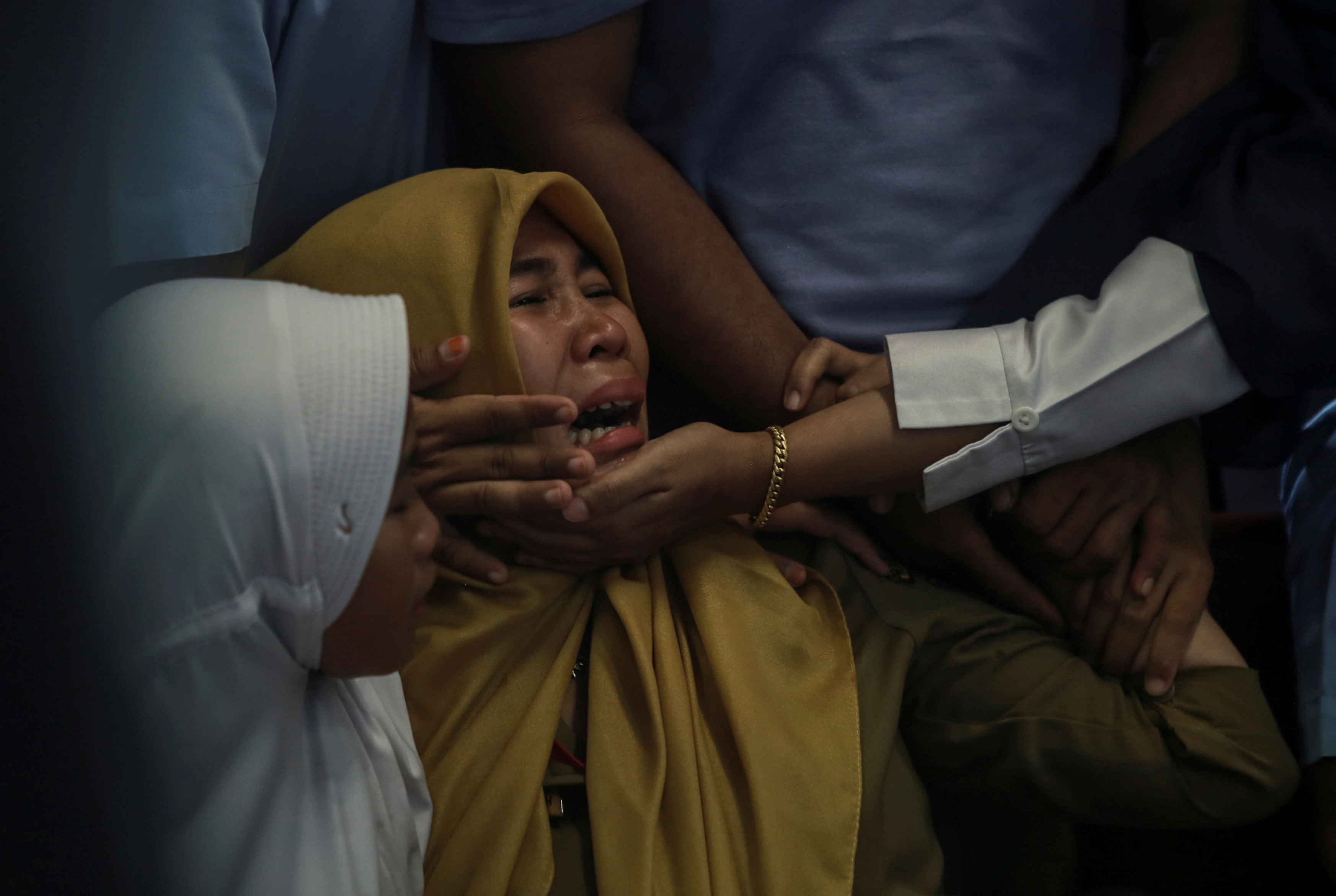 Relatives of passengers of Lion Air, flight JT610, that crashed into the sea cry at Depati Amir Airport in Pangkal Pinang, Belitung island, Indonesia, October 29, 2018. Antara Foto/Hadi Sutrisno via REUTERS