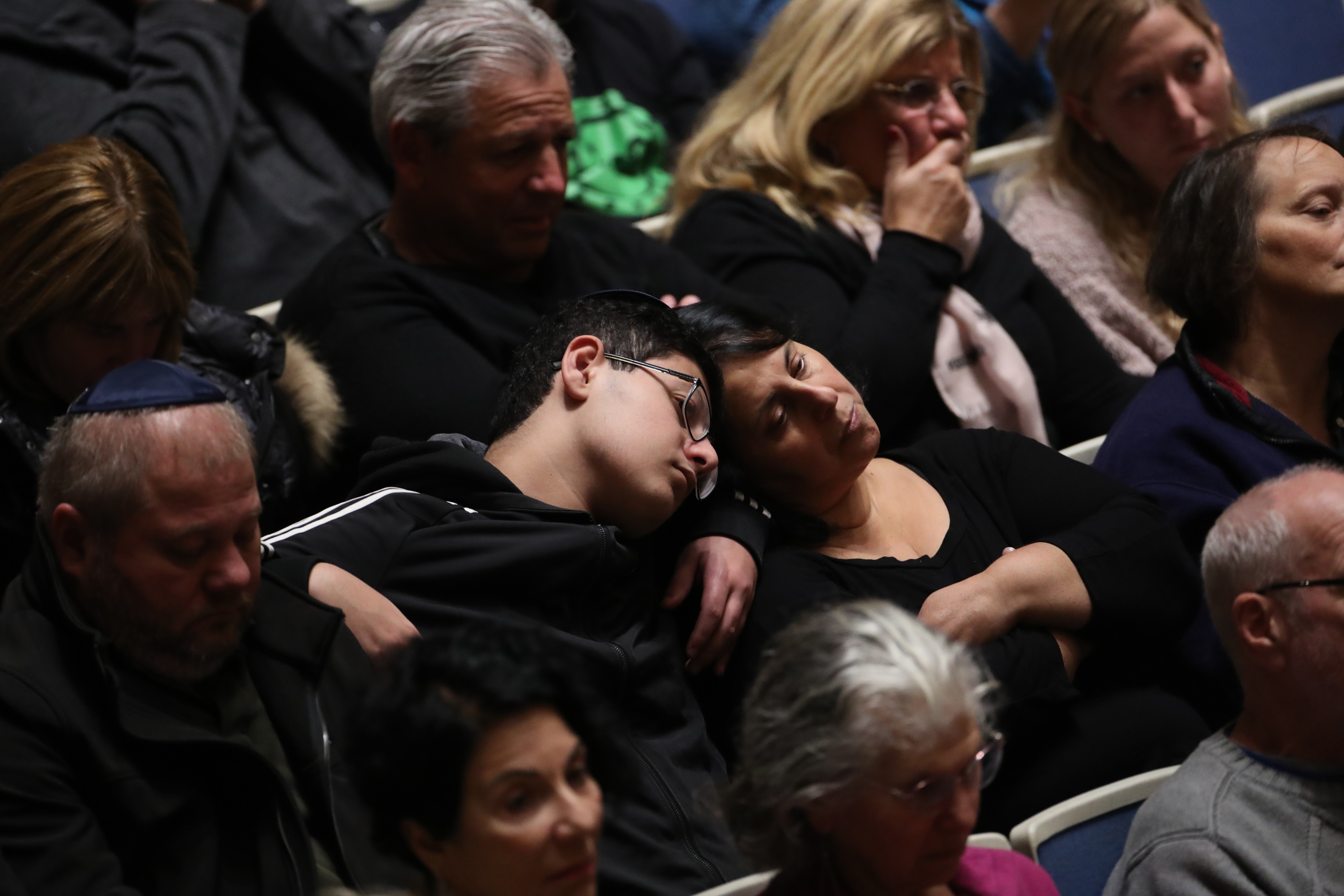 Mourners attend a memorial service at the Sailors and Soldiers Memorial Hall of the University of Pittsburgh, a day after 11 worshippers were shot dead at a Jewish synagogue in Pittsburgh, Pennsylvania, U.S., October 28, 2018. REUTERS/Cathal McNaughton