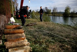 A deminer from a bomb-disposal unit moves an unexploded shell recovered in the Meuse River at Sivry-sur-Meuse, close to WWI battlefields, near Verdun, France, October 23, 2018 before the centenial commemoration of the First World War Armistice Day. REUTERS/Pascal Rossignol