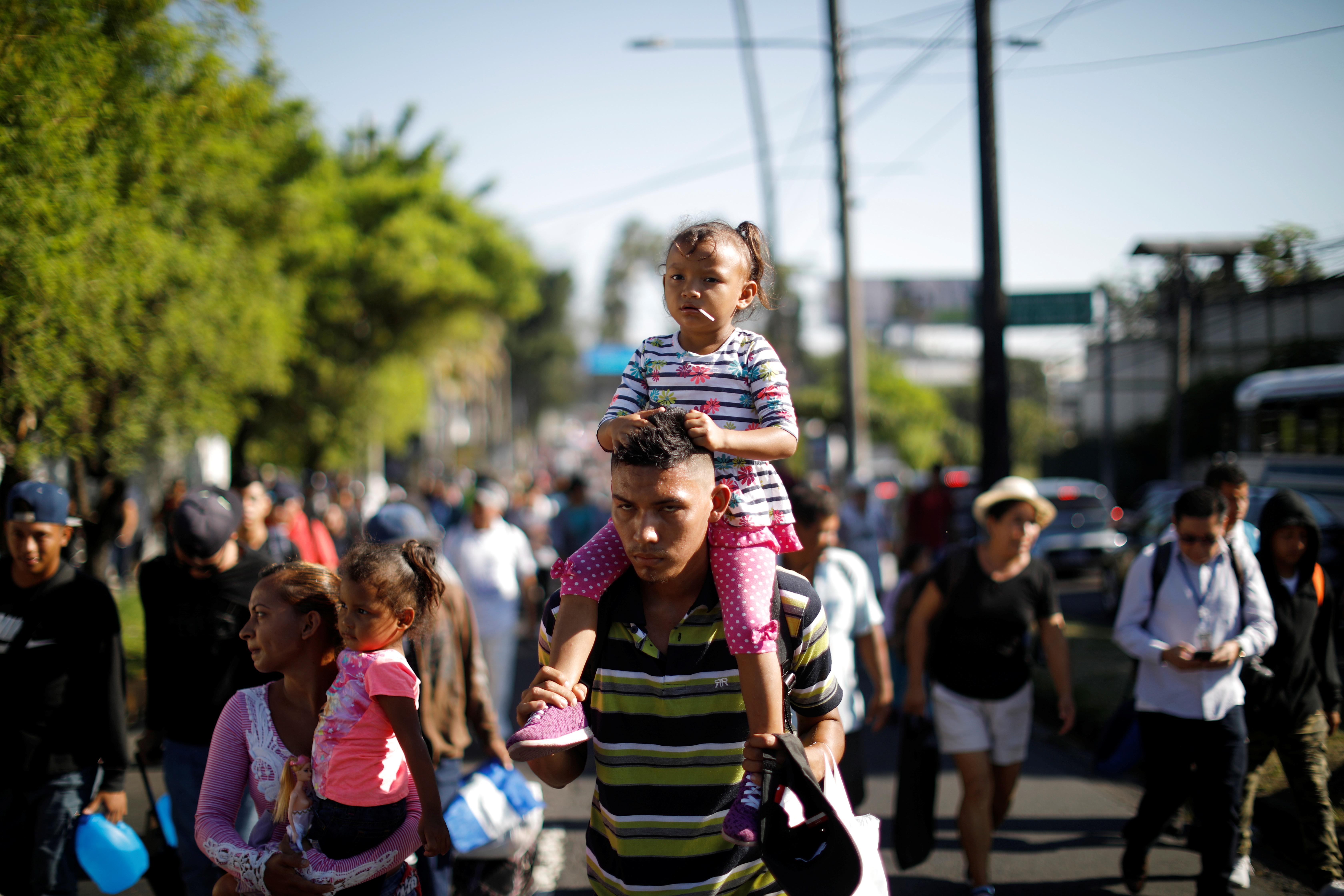 People walk in a caravan of migrants departing from El Salvador en route to the United States, in San Salvador, El Salvador, October 31, 2018. REUTERS/Jose Cabezas
