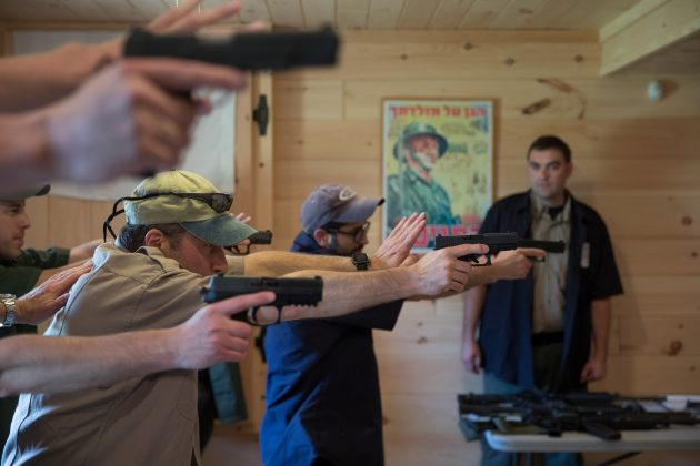 Trainees practice an Israeli shooting method as they take part in the Cherev Gidon Firearms Training Academy in Honesdale, Pennsylvania, U.S. August 5, 2018. REUTERS/Noam Moskowitz