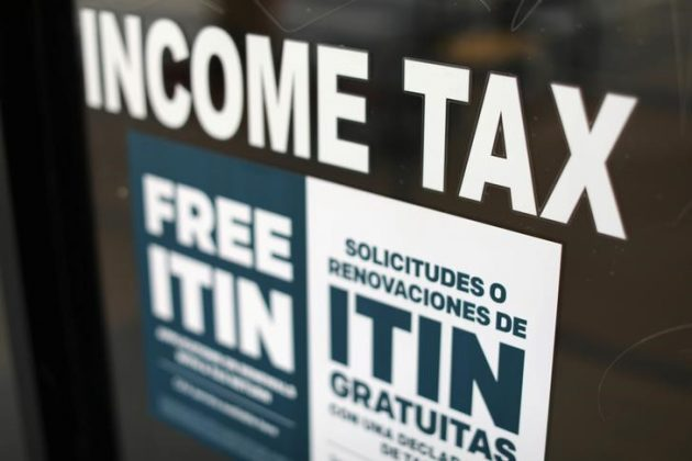 A tax sign is pictured on an H&R Block tax office in Los Angeles, California, U.S., April 26, 2017. REUTERS/Mike Blake