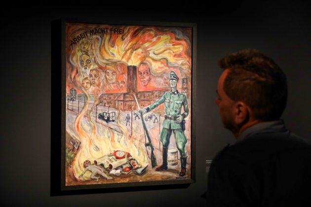 A man looks at a painting during the opening of an exhibition featuring works by David Olere, a prisoner in Auschwitz concentration camp, at the museum in Oswiecim, Poland October 30, 2018. Picture taken October 30, 2018. Agencja Gazeta/Jakub Porzycki via REUTERS