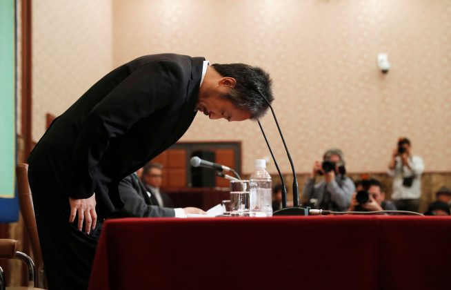 Jumpei Yasuda, the Japanese journalist held in Syria for more than three years, bows during a news conference for the first time since his release last month, at the Japan National Press Club in Tokyo, Japan November 2, 2018. REUTERS/Issei Kato