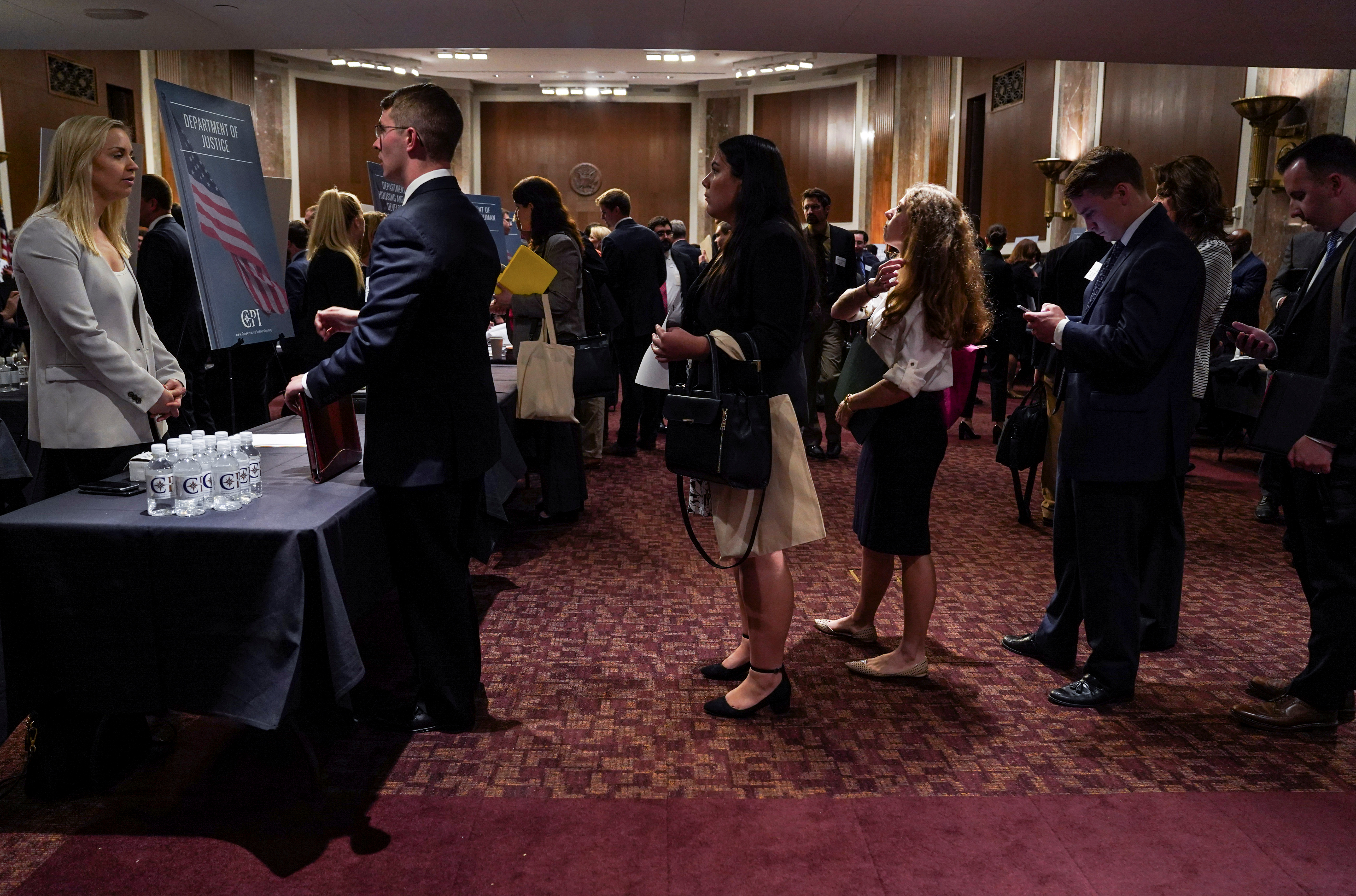 People wait in line at a stand during the Executive Branch Job Fair hosted by the Conservative Partnership Institute at the Dirksen Senate Office Building in Washington, U.S., June 15, 2018. REUTERS/Toya Sarno Jordan