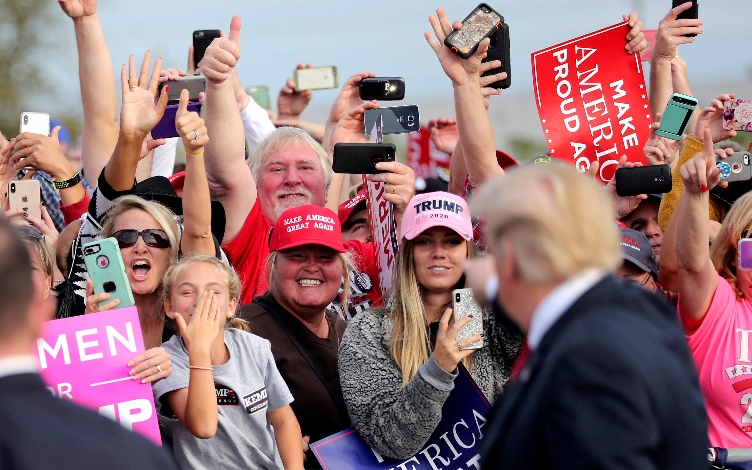 Supporters applaud U.S. President Donald Trump as he arrives to attend a campaign rally at Middle Georgia Regional Airport in Macon, Georgia, U.S., November 4, 2018. REUTERS/Jonathan Ernst/File Photo