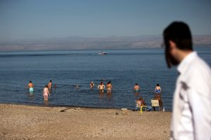 People cool off in the Sea of Galilee in northern Israel November 1, 2018. Picture taken November 1, 2018. REUTERS/Ronen Zvulun