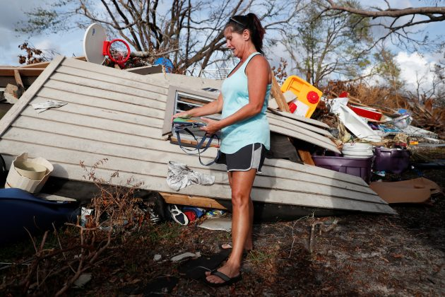 Denise Bass, 56, looks through her belongings in the aftermath of Hurricane Michael at her home in Lynn Haven, Florida, U.S., November 5, 2018. REUTERS/Terray Sylvester