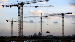 Cranes are seen at a construction site in the new neighbourhood of Carmei Gat in the southern Israeli city of Kiryat Gat November 1, 2016. REUTERS/Amir Cohen/File Photo