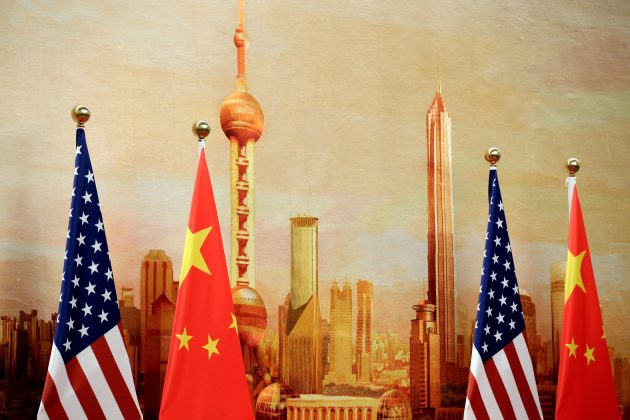 FILE PHOTO: U.S. and Chinese flags are placed for a joint news conference by U.S. Secretary of State Mike Pompeo and Chinese Foreign Minister Wang Yi at the Great Hall of the People in Beijing, China June 14, 2018. REUTERS/Jason Lee/File Photo