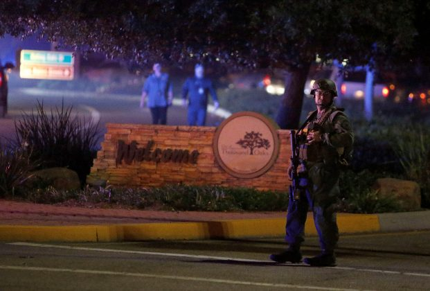 Police guard the site of a mass shooting at a bar in Thousand Oaks, California, U.S. November 8, 2018. REUTERS/Ringo Chiu