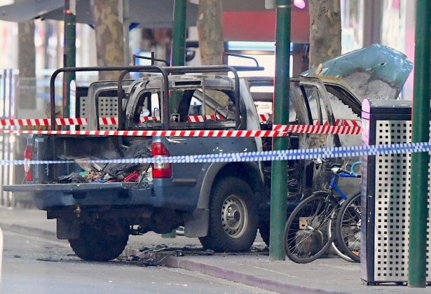 A burnt out vehicle is surrounded by police tape on Bourke Street in central Melbourne, Australia, November 9, 2018. AAP/James Ross/via REUTERS