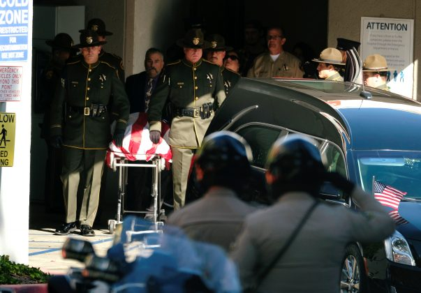 The body of Ventura County Sheriff Sgt. Ron Helus, who was shot and killed in a mass shooting at a bar is transferred to a hearse for procession from the Los Robles Medical Center in Thousand Oaks, California, U.S., November 8, 2018. REUTERS/Ringo Chiu