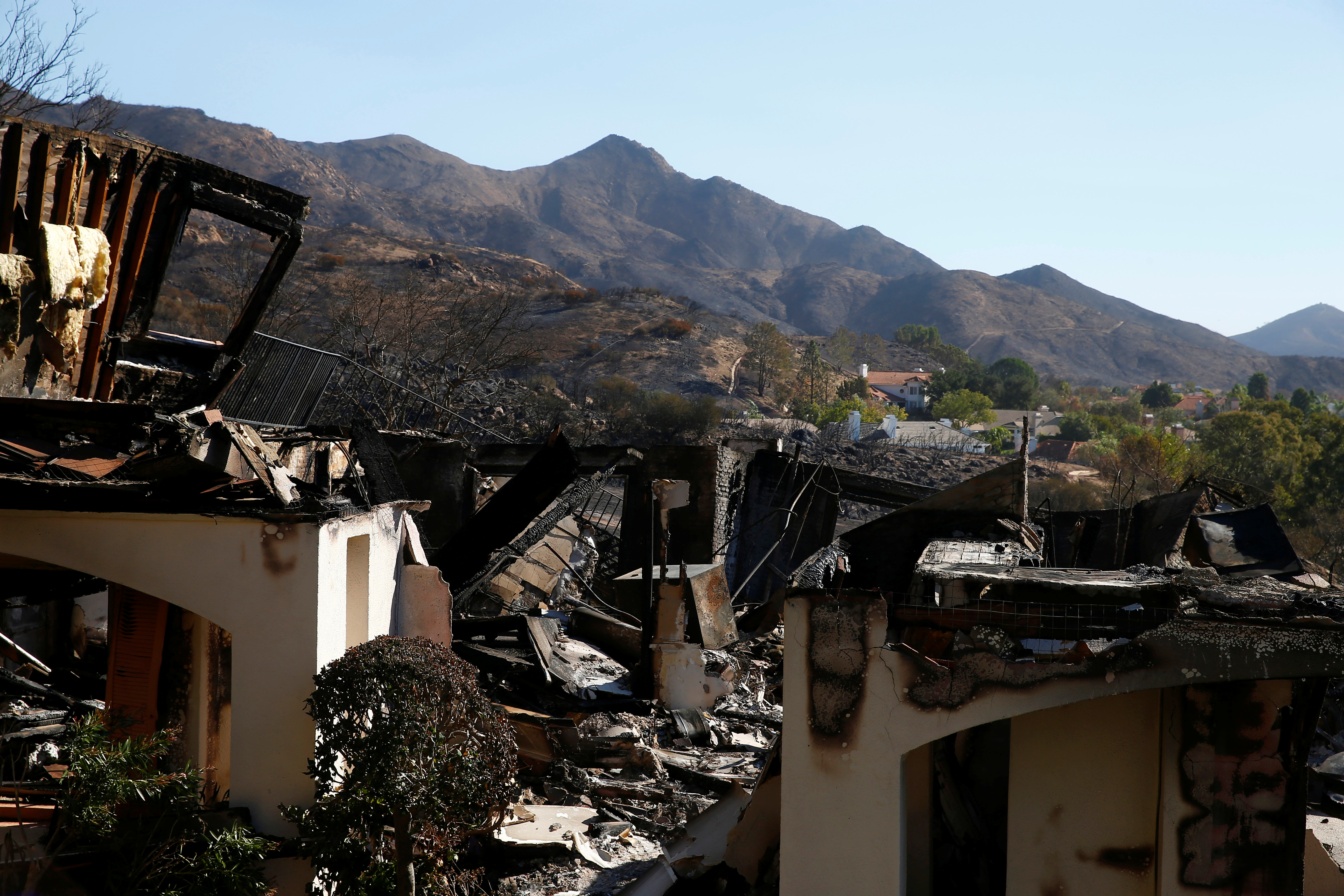 A home destroyed by the Woolsey Fire is seen in Thousand Oaks, California, U.S. November 12, 2018. REUTERS/Eric Thayer