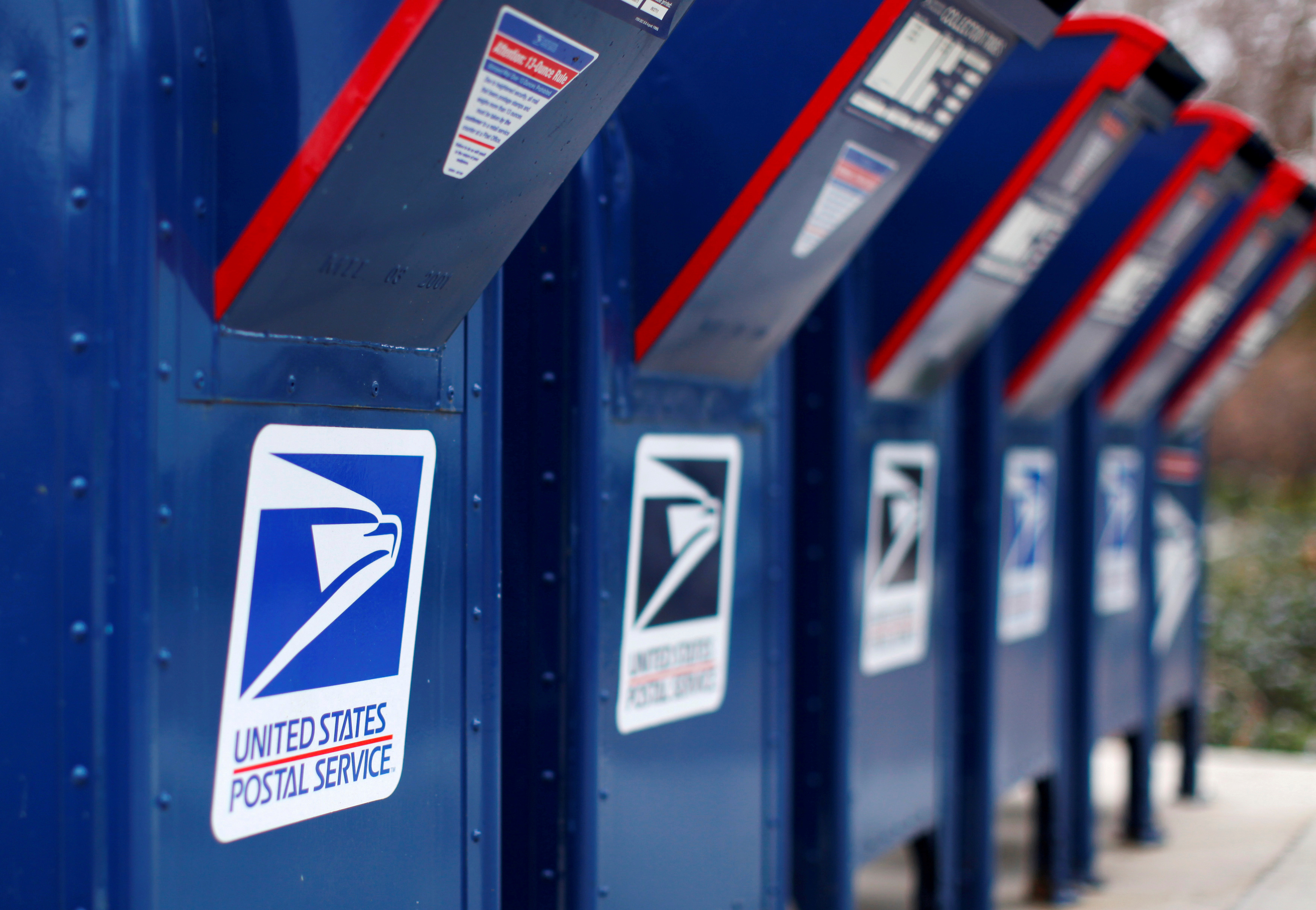 FILE PHOTO: A view shows U.S. postal service mail boxes at a post office in Encinitas, California February 6, 2013. REUTERS/Mike Blake/File Photo