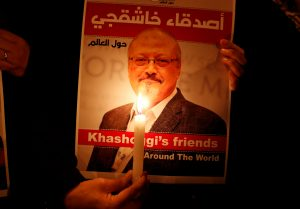 FILE PHOTO: A demonstrator holds a poster with a picture of Saudi journalist Jamal Khashoggi outside the Saudi Arabia consulate in Istanbul, Turkey October 25, 2018. REUTERS/Osman Orsal/File Photo