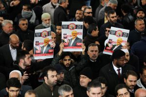 People holding pictures of Saudi journalist Jamal Khashoggi attend a symbolic funeral prayer for Khashoggi at the courtyard of Fatih mosque in Istanbul, Turkey November 16, 2018. REUTERS/Huseyin Aldemir