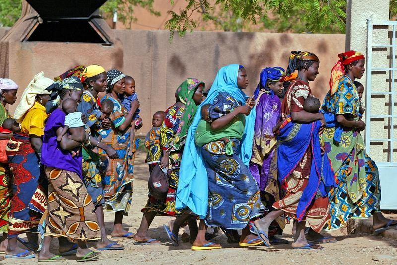 Rural women who have carried their malnourished children for days across the Sahel desert in search of [food] rush into an emergency feeding center in the town of Guidan Roumdji, southern Niger, July 1, 2005. [Niger's severe food crisis could have been prevented if the United Nations had a reserve fund to jump-start humanitarian aid while appeals for money were considered, a senior U.N. official said on July 19. Some 3.6 million people are in need of food, among them 800,000 malnourished children. About 150,000 may die unless food arrives quickly in the impoverished West African nation of 13 million.] Picture taken July 1, 2005. - PBEAHUNYKGE