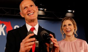 FILE PHOTO: Republican U.S. Senate candidate Rick Scott is accompanied by his daughter Allison Guimard as he addresses supporters at his midterm election night party in Naples, Florida, U.S. November 6, 2018. REUTERS/Joe Skipper/File Photo