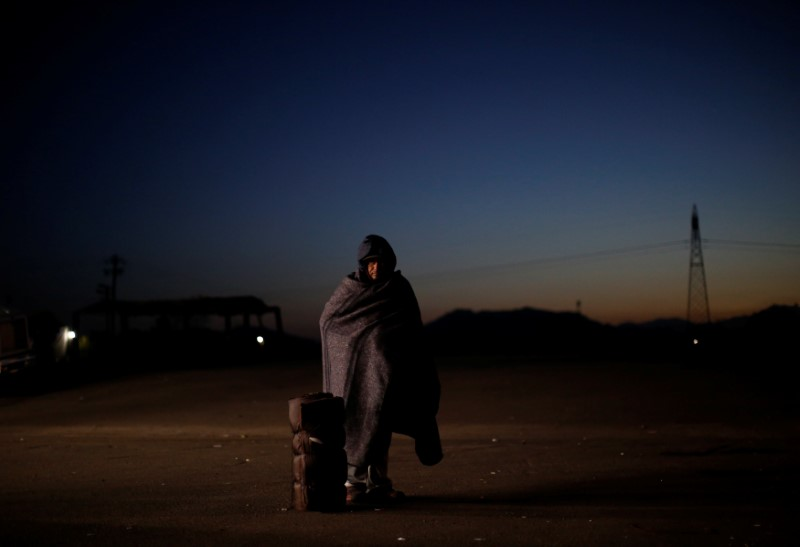 A migrant from Honduras, part of a caravan of thousands traveling from Central America to the United States, prepares to get on a bus bound for Mexicali at a makeshift camp in Navojoa, Mexico November 17, 2018. REUTERS/Kim Kyung-Hoon