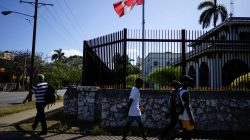 People pass by the Canada's Embassy in Havana, Cuba, April 16, 2018. REUTERS/Alexandre Meneghini