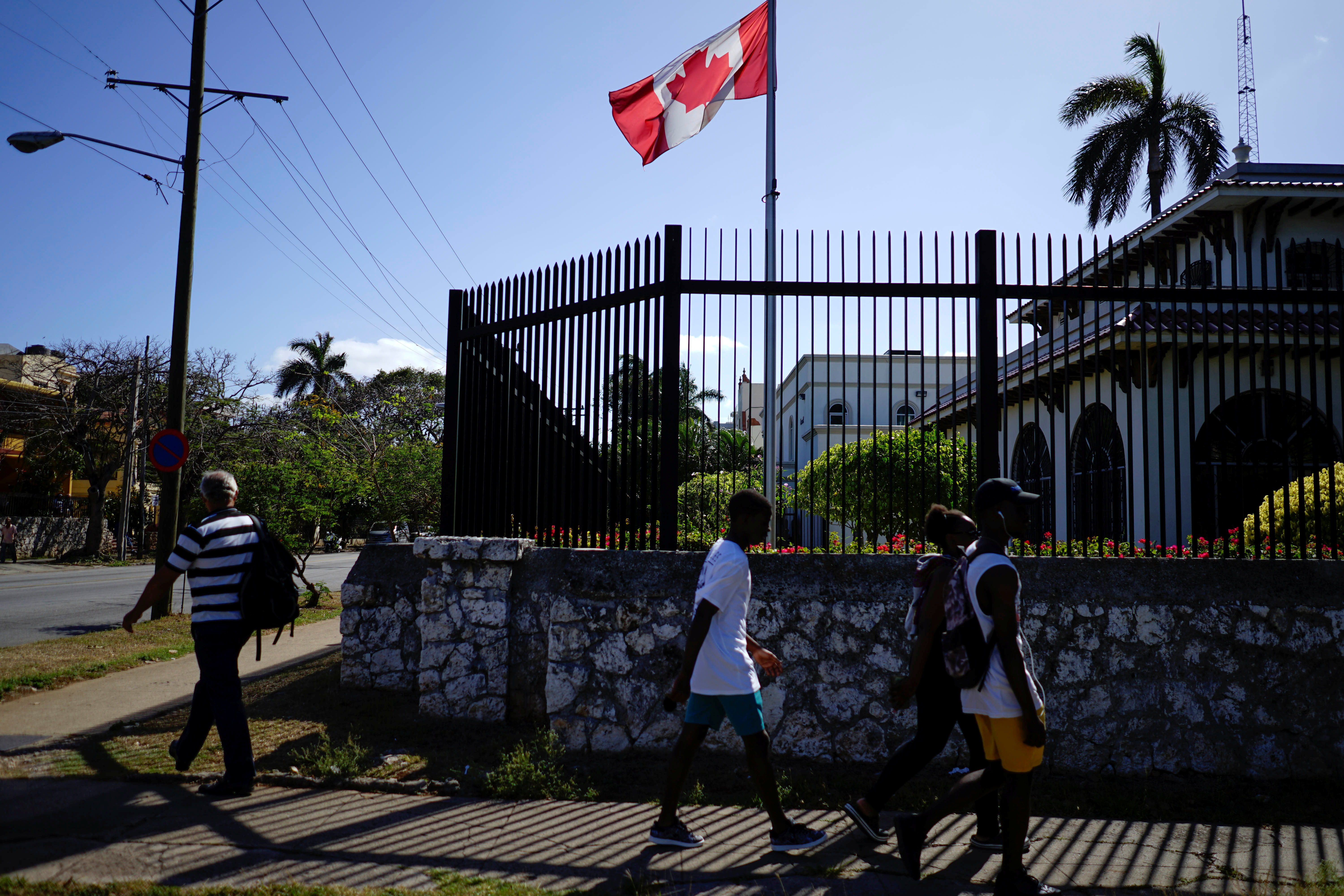 People pass by the Canada's Embassy in Havana, Cuba, April 16, 2018. REUTERS/Alexandre Meneghini