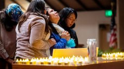 Lidia Steineman, who lost her home, prays during a vigil for the lives and community lost to the Camp Fire at the First Christian Church of Chico in Chico, California, November 18, 2018. Noah Berger/Pool via REUTERS