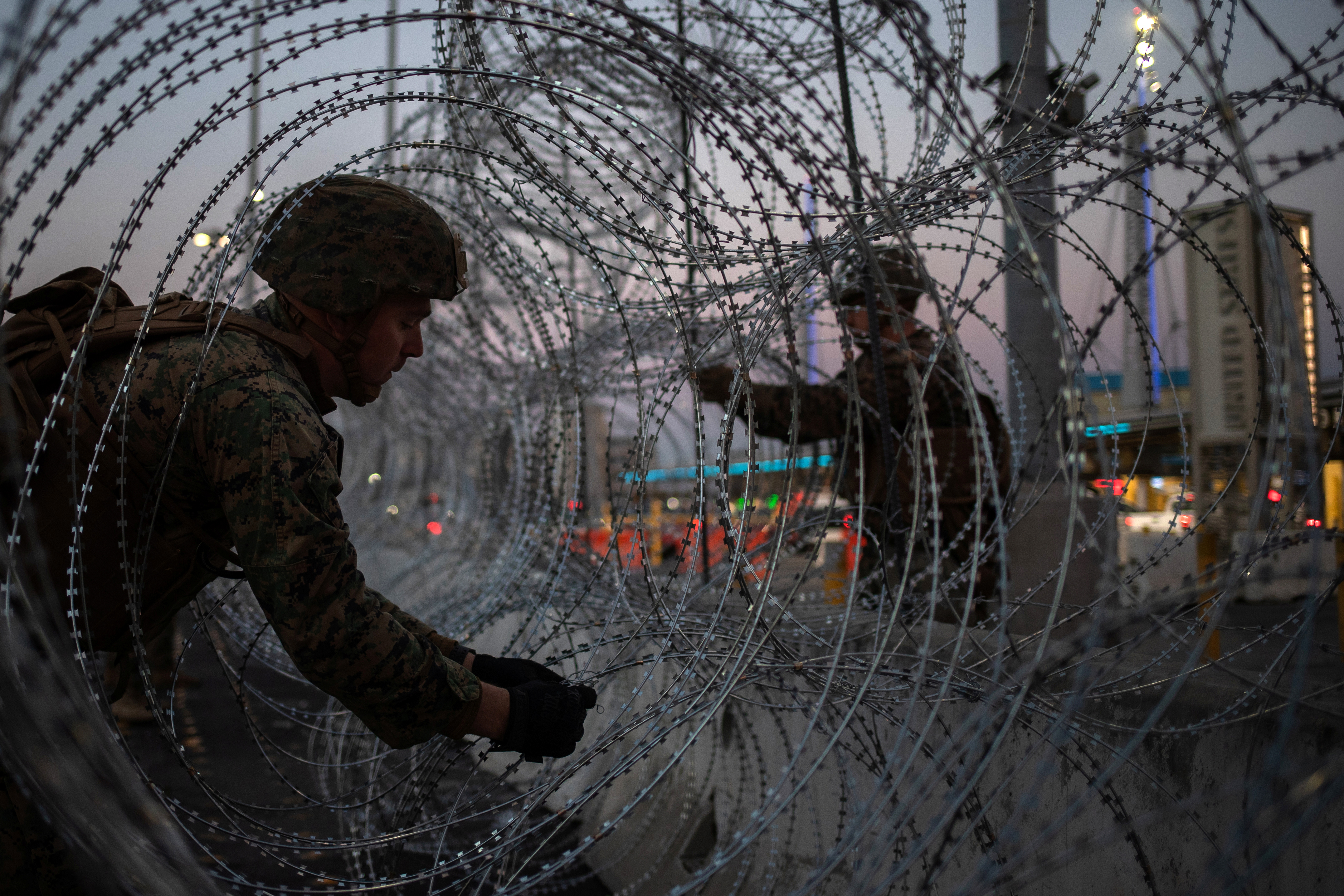 United States Marines fortify concertina wire along the San Ysidro Port of Entry border crossing as seen from Tijuana, Mexico November 20, 2018. REUTERS/Adrees Latif