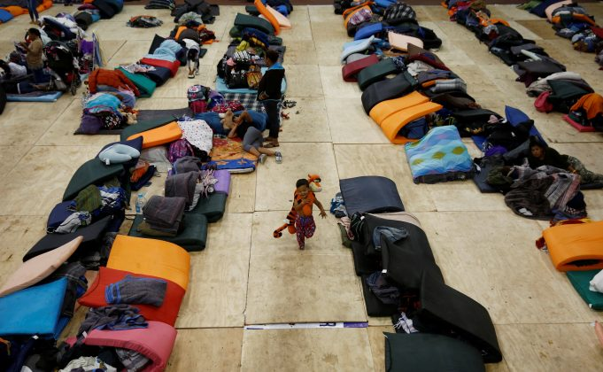 A migrant boy, part of a caravan of thousands traveling from Central America en route to the United States, runs while holding a toy at a temporary shelter in Tijuana, Mexico November 22, 2018. REUTERS/Kim Kyung-Hoon