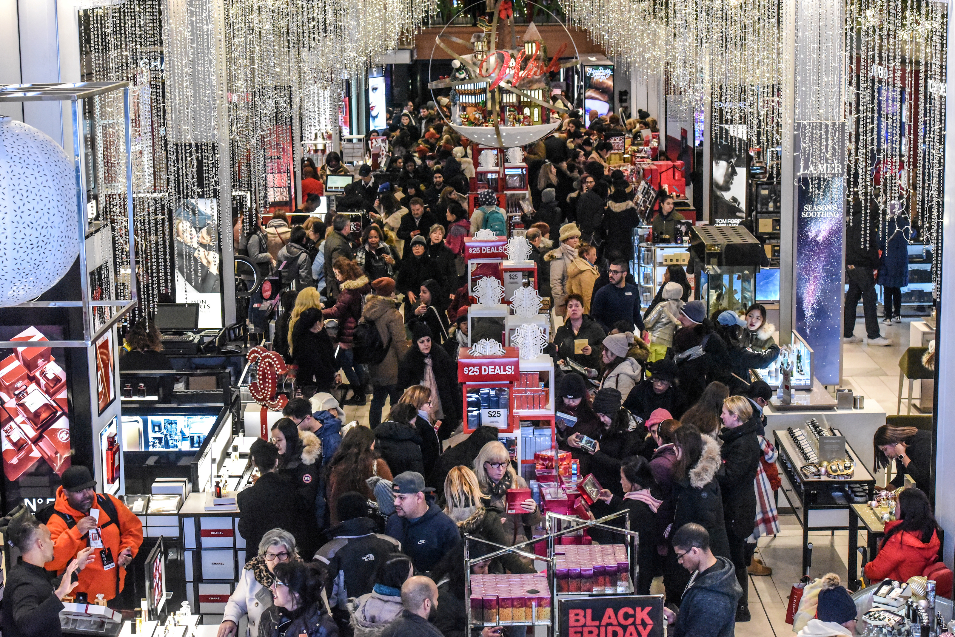 A large crowd of people shop during a Black Friday sales event at Macy's flagship store on 34th St. in New York City, U.S., November 22, 2018. REUTERS/Stephanie Keith