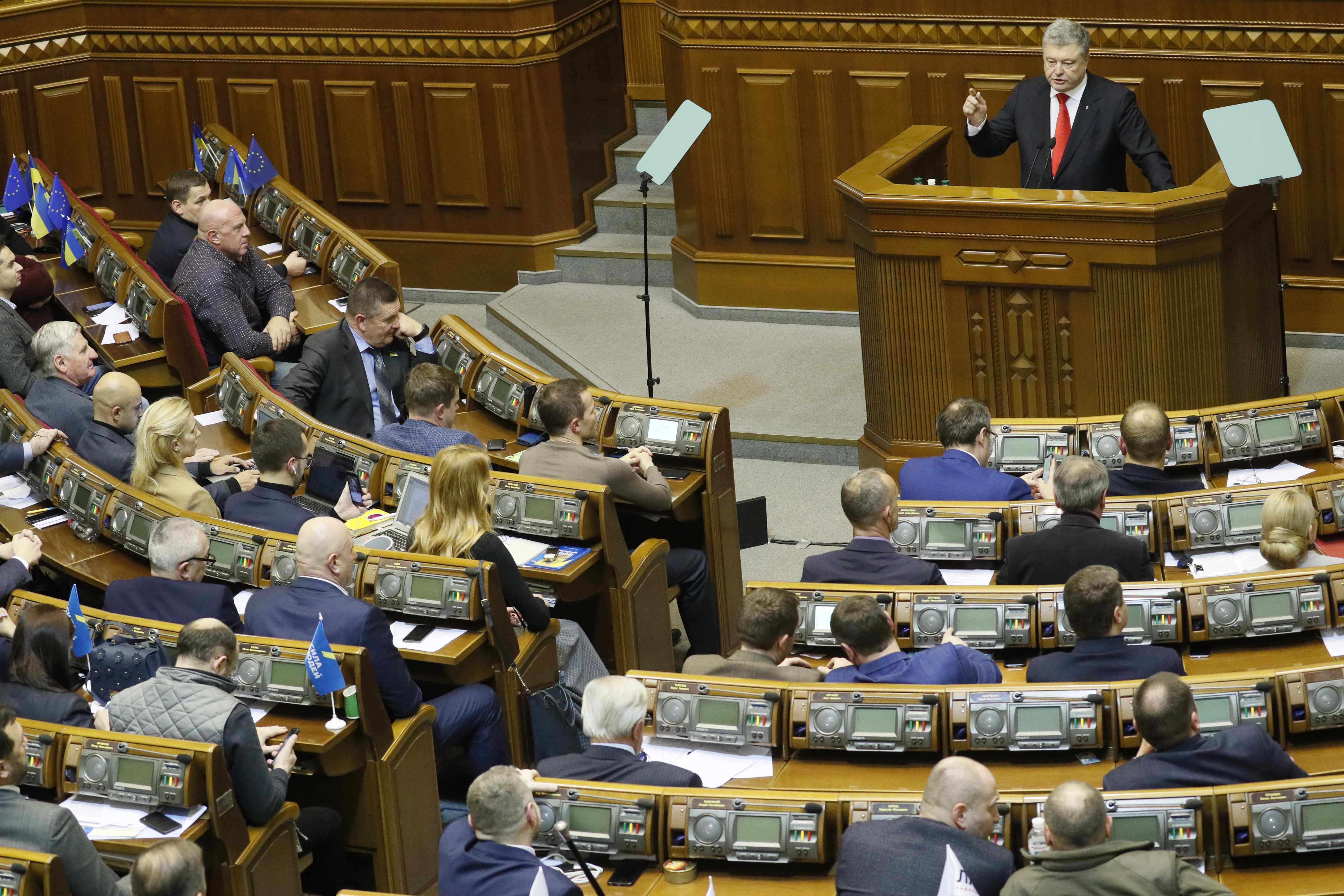 Ukrainian President Petro Poroshenko speaks during a parliament session to review his proposal to introduce martial law for 60 days after Russia seized Ukrainian naval ships off the coast of Russia-annexed Crimea, in Kiev, Ukraine November 26, 2018. REUTERS/Valentyn Ogirenko