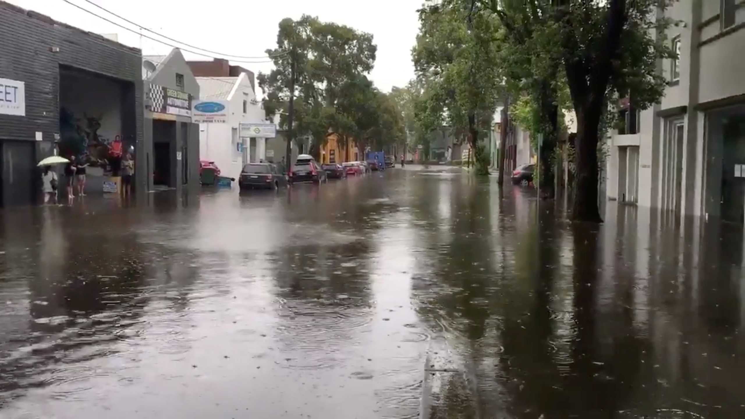 A flooded street in Sydney, New South Wales, Australia November 28, 2018, in this still image taken from a video obtained from social media. @DeeCee451/via REUTERS