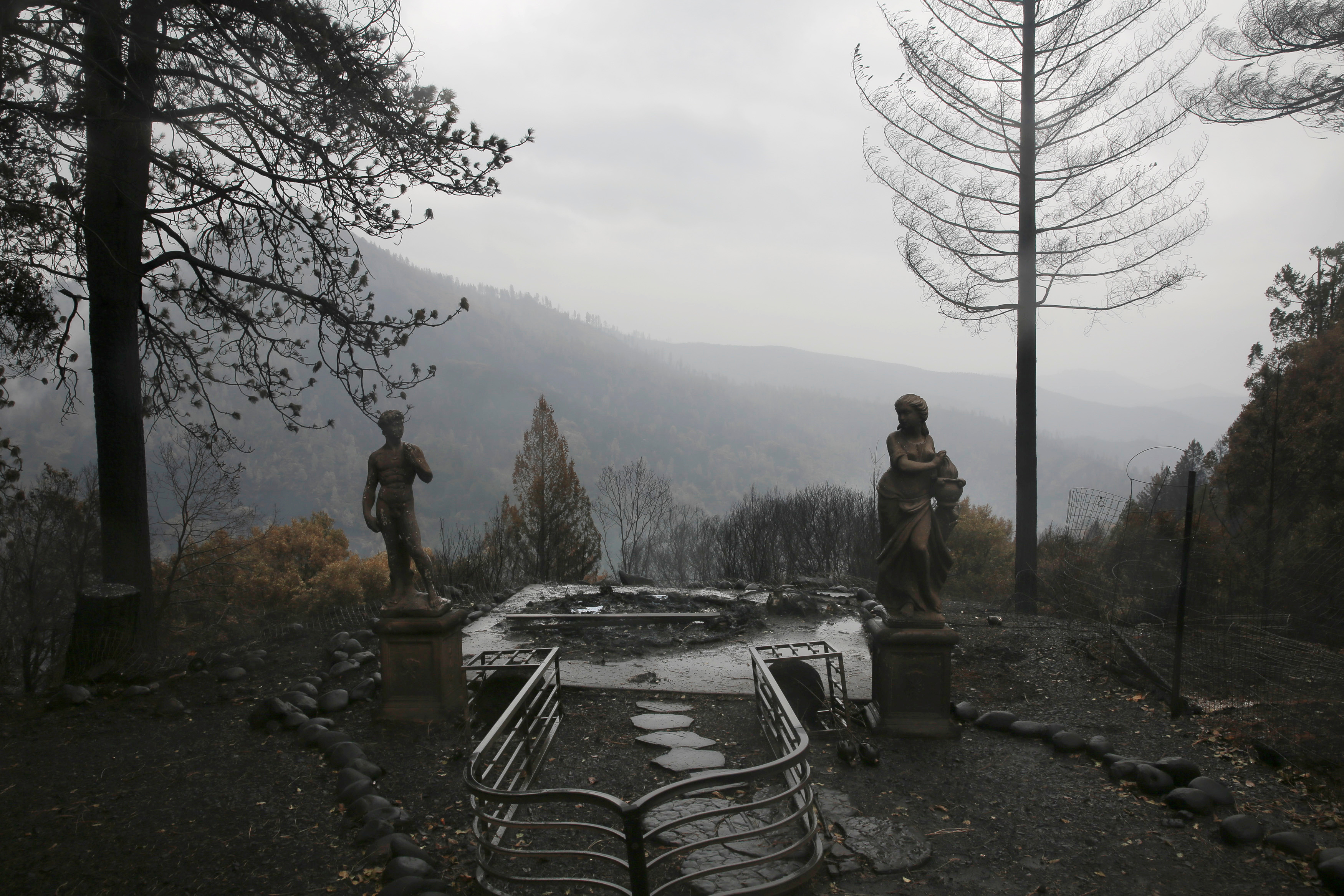 FILE PHOTO: Statues are seen on a property damaged by the Camp Fire in Paradise, California, U.S. November 21, 2018. REUTERS/Elijah Nouvelage