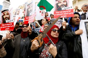 FILE PHOTO: A woman takes part in a protest opposing the visit of Saudi Arabia's Crown Prince Mohammed bin Salman in Tunis, Tunisia, November 27, 2018. REUTERS/Zoubeir Souissi/File Photo