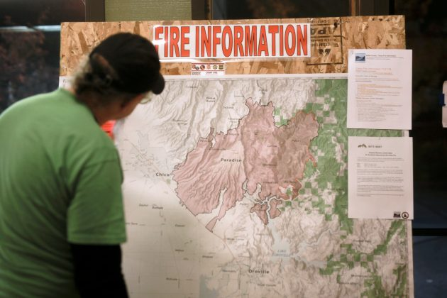 FILE PHOTO: A man looks at a map of the Camp Fire at a Red Cross shelter in Chico, California, U.S. November 21, 2018. REUTERS/Elijah Nouvelage/File Photo