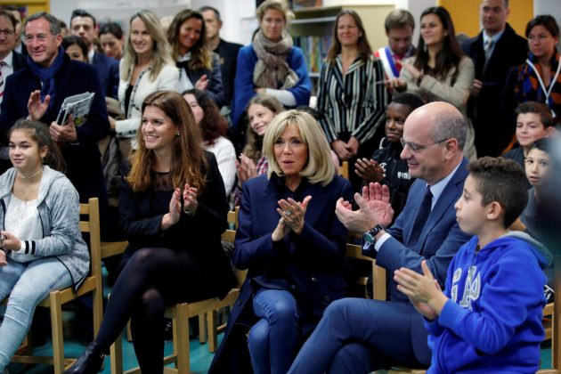 FILE PHOTO: Brigitte Macron, wife of French President, French Education Minister Jean-Michel Blanquer and Marlene Schiappa, French Junior Minister for Gender Equality, applaud during a visit at a high school to discuss the fight against school bullying in Clamart, France, November 15, 2018. REUTERS/Philippe Wojazer /File Photo