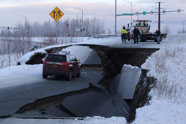 A stranded vehicle lies on a collapsed roadway near the airport after an earthquake in Anchorage, Alaska, U.S. November 30, 2018. REUTERS/Nathaniel Wilder