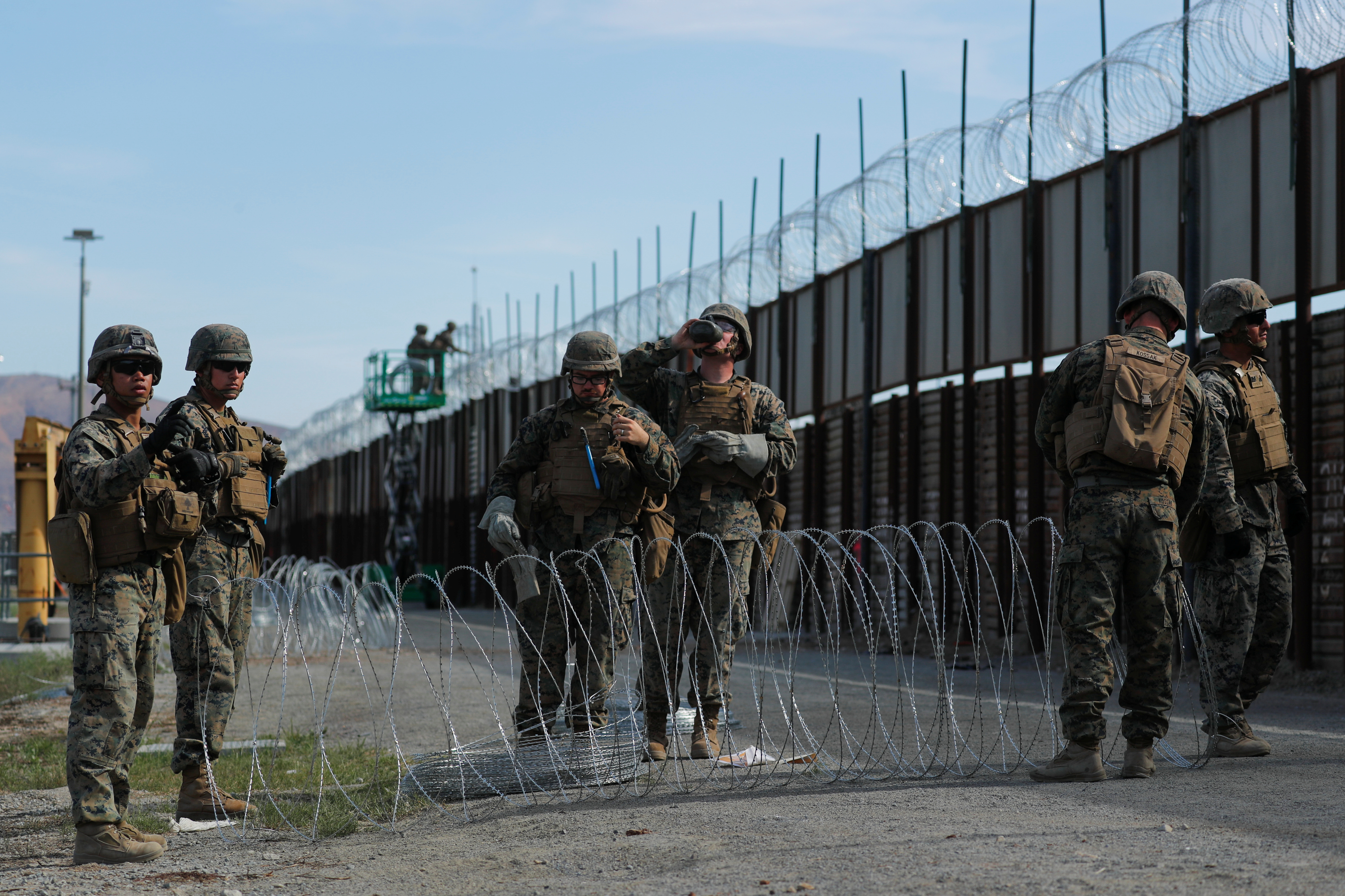 FILE PHOTO: U.S. Marines deploy concertina wire at the U.S. Mexico border in preparation for the arrival of a caravan of migrants at the San Ysidro border crossing in San Diego, California, U.S. November 15, 2018. REUTERS/Mike Blake
