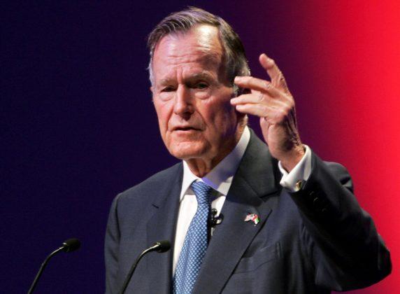 FILE PHOTO: Former U.S. President George H.W. Bush speaks at the World Leadership Summit in Abu Dhabi, United Arab Emirates November 21, 2006. REUTERS/Stringer/File Photo