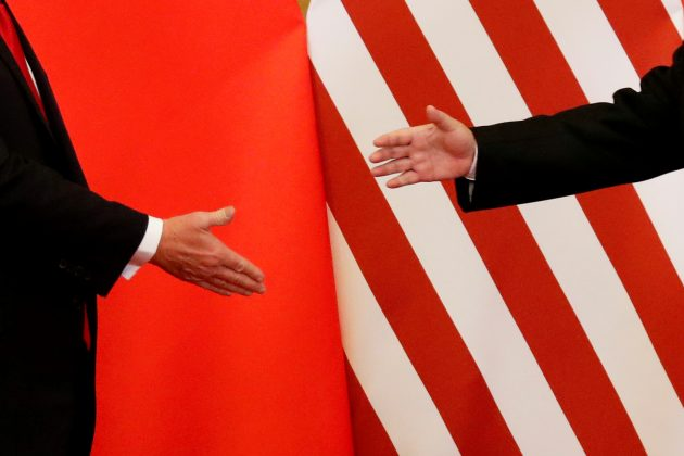 FILE PHOTO: U.S. President Donald Trump and China's President Xi Jinping shake hands after making joint statements at the Great Hall of the People in Beijing, China, November 9, 2017. REUTERS/Damir Sagolj/File Photo
