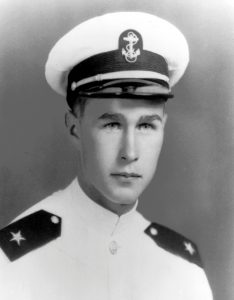 FILE PHOTO: George H. W. Bush, in uniform as a Naval Aviator Cadet, is pictured in this early 1943 handout photo obtained by Reuters November 30, 2012. George Bush Presidential Library and Museum/Handout via REUTERS/File Photo