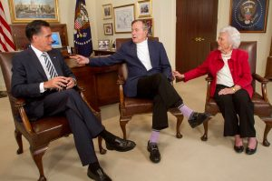 FILE PHOTO: Republican presidential candidate Mitt Romney (L) picks up the formal endorsement of former President George H.W. Bush and former first lady Barbara Bush in Houston March 29, 2012. REUTERS/Donna Carson/File Photo